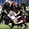 Foxborough: A host of Bishop Fenwick defenders stuff Northbridge running back Taylor Clark for a loss of yards during the D5 State Championship on Saturday evening at Gillette Stadium. Bishop Fenwick captured the D5 State Title with a dominant 28-0 win over the Rams. DAVID LE/Staff Photo 12/7/13