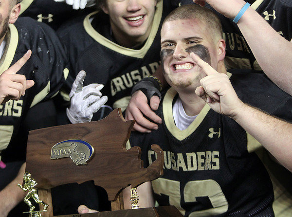 Foxborough: Bishop Fenwick senior captain Charlie St. Pierre smiles while holding the D5 State Championship trophy after the Crusaders'  28-0 over Northbridge on Saturday evening at Gillette Stadium. DAVID LE/Staff Photo 12/7/13