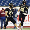 Foxborough: Bishop Fenwick senior captain Nick Bona (5) pumps his fists and screams in celebration after dragging down Northbridge sophomore Chandler Brooks for a loss of yards during the D5 State Championship on Saturday evening at Gillette Stadium. DAVID LE/Staff Photo 12/7/13