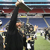 Foxborough: Bishop Fenwick defensive coordinator Dave Dugan holds the D5 State Championship trophy high over his head after the Crusaders 28-0 win over Northbridge on Saturday evening at Gillette Stadium. DAVID LE/Staff Photo 12/7/13