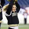 Foxborough: Bishop Fenwick junior Carly D'Eon performs with the rest of the Crusaders cheerleaders during the D5 State Championship on Saturday evening at Gillette Stadium. DAVID LE/Staff Photo 12/7/13