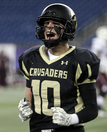 Foxborough: Bishop Fenwick senior Tom Parsons pumps his fists while walking off the field following a 28-0 win over Northbridge in the D5 State Championship on Saturday evening at Gillette Stadium. DAVID LE/Staff Photo 12/7/13