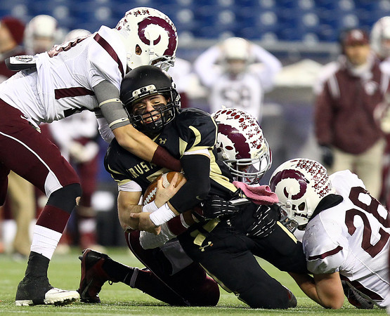 Foxborough: Bishop Fenwick senior captain Nick Bona (5) falls forward for a few extra yards while being brought down by multiple Northbridge defenders during the D5 State Championship on Saturday evening at Gillette Stadium. DAVID LE/Staff Photo 12/7/13
