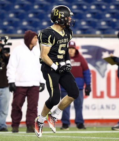 Foxborough: Bishop Fenwick senior captain Nick Bona (5) leaps in the air and whoops in excitement after dragging down Northbridge sophomore Chandler Brooks down for a loss of yards during the D5 State Championship on Saturday evening at Gillette Stadium. DAVID LE/Staff Photo 12/7/13