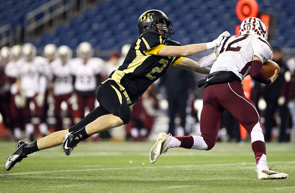 Foxborough: Bishop Fenwick senior Kevin Hannon (2) dives and tracks down Northbridge quarterback Koby Schofer (12) during the D5 State Championship on Saturday evening at Gillette Stadium. DAVID LE/Staff Photo 12/7/13