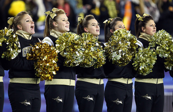Foxborough: The Bishop Fenwick cheerleaders cheer on the Crusaders during the D5 State Championship on Saturday evening at Gillette Stadium. DAVID LE/Staff Photo 12/7/13