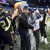 Foxborough: Bishop Fenwick Head Coach Dave Woods and defensive coordinator Dave Dugan get doused with water after the Crusaders defeated Northbridge 28-0 in the D5 State Championship on Saturday evening at Gillette Stadium. DAVID LE/Staff Photo 12/7/13
