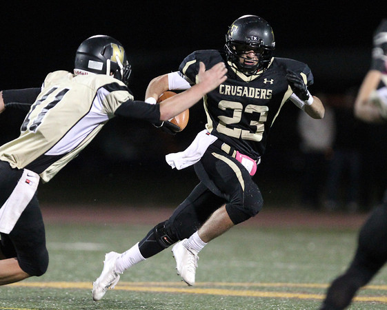 Peabody: Bishop Fenwick senior captain Charlie Maistrellis (23) makes a quick juke move to get outside Northeast Regional senior Troy Tartarini (11) and sprints untouched into the end zone for a long touchdown run. David Le/Salem News