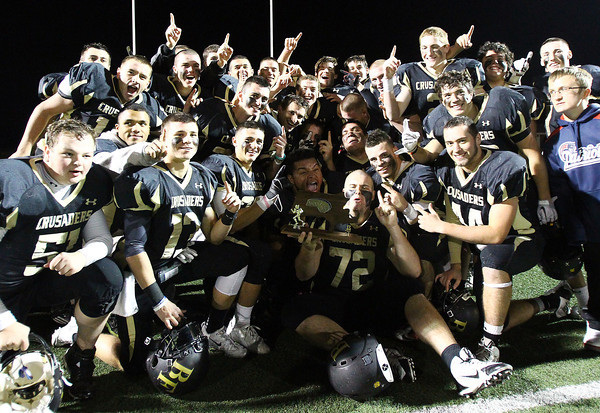 Peabody: The Bishop Fenwick football team gathers around the D5 North Championship trophy after handily defeating Northeast Regional on Friday evening. David Le/Salem News