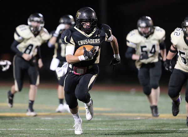 Peabody: Bishop Fenwick senior captain Charlie Maistrellis (23) breaks away from the entire Northeast Regional defense on a 54-yard punt return touchdown on Friday evening. David Le/Salem News
