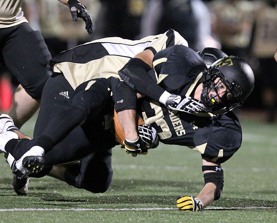 Peabody: Bishop Fenwick junior running back Robert Carillo (33) plows ahead for a few extra yards while being brought down by a Northeast Regional player on Friday evening. David Le/Salem News