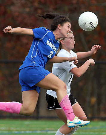 Marblehead: Danvers senior captain Kylie Plaza (3) leaps and beats Marblehead senior Abby LeBlanc (7) to a header during the second half of play in the D2 North first round game on Friday afternoon at Piper Field in Marblehead. David Le/Salem News