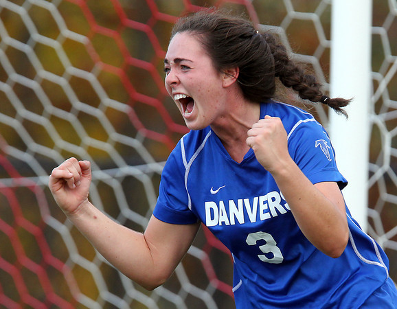 Marblehead: Danvers senior captain Kylie Plaza (3) pumps both her fists and screams in excitement after scoring the game-tying-goal against Marblehead on Friday afternoon. Plaza and the Falcons took home a 2-1 victory in the first round of the Division 2 North tournament with a 4-2 decision in PK's. David Le/Salem News