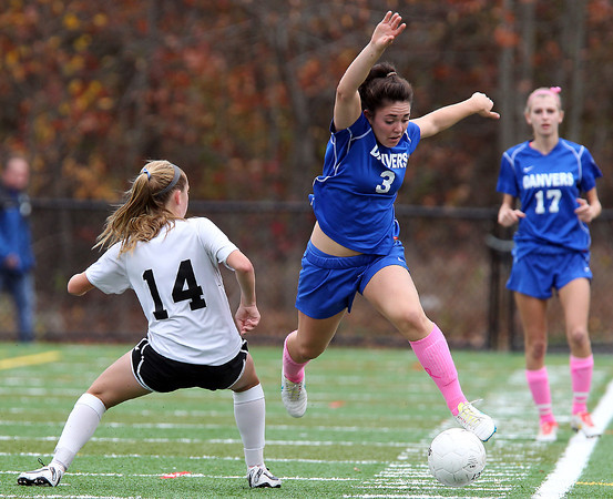 Marblehead: Danvers senior captain Kylie Plaza (3) flies in the air as she makes a move around Marblehead freshman Lucie Poulin (14) on Friday afternoon. David Le/Salem News