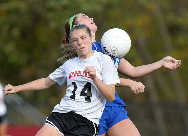 Marblehead: Marblehead freshman Lucie Poulin (14) and Danvers junior Shannon Pohle (16) collide as they battle for a 50/50 ball during the second half of the D2 North first round game on Friday afternoon at Piper Field in Marblehead. David Le/Salem News