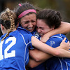 Marblehead: Danvers senior captain Kylie Plaza (3), right, gets mobbed by senior Courtney Arnoldy (18), center, and junior Meaghan McCarriston (12), after Plaza scored the game-tying-goal in the D2 North first round game against Marblehead on Friday afternoon. The Falcons and the Magicians played to a 1-1 draw after 2 overtime periods, and the Falcons captured the win with a 4-2 decision in Penalty Kicks. David Le/Salem News
