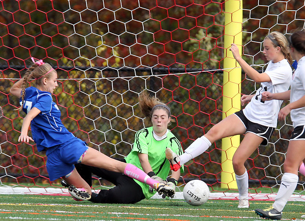 Marblehead: Marblehead sophomore goalie Lauren Unterborn, center, makes a save as teammate Meagan Hanratty (11) tries to clear the ball away from sliding Danvers junior Emily Murphy (17) on Friday afternoon. David Le/Salem News