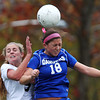 Marblehead: Danvers senior Courtney Arnoldy (18) wins a header against Marblehead sophomore Elise Joyce (5) during the first overtime period on Friday afternoon in the D2 North first round game. David Le/Salem News