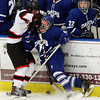 Salem: Marblehead senior captain Liam Gillis (9), left, checks Danvers' Alec Littlefield hard into against the boards during the second period of play at Rockett Arena at Salem State University on Wednesday evening. Gillis and the Headers defeated the Falcons 4-1 in NEC action. DAVID LE/Staff Photo