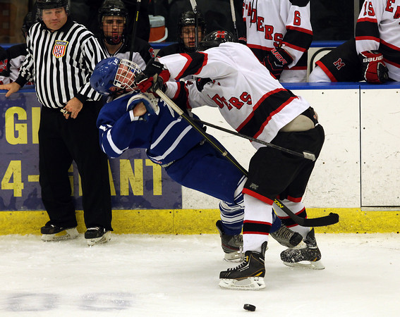 Salem: Marblehead senior captain Liam Gillis (9) levels Danvers' Steven Ganley (15) to separate him from the puck at Rockett Arena at Salem State University on Wednesday evening. DAVID LE/Staff Photo