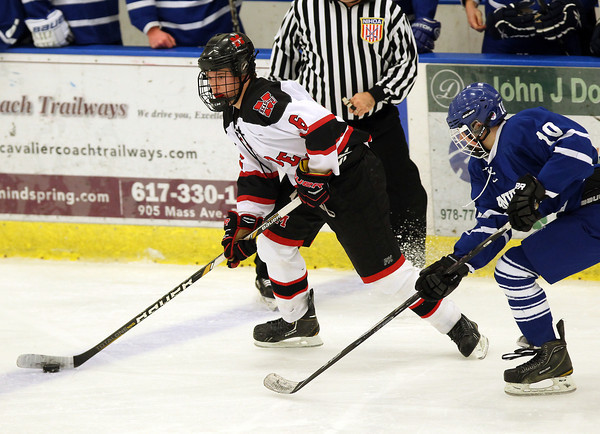 Salem: Marblehead sophomore defenseman PJ Roy (6) controls the puck while being pursued by Danvers' Robert Tibbetts (10) during the second period of play at Rockett Arena at Salem State University on Wednesday evening. DAVID LE/Staff Photo