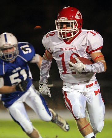 Danvers: Masco junior wide receiver Cory Tines (12) turns the corner on a wide receiver reverse against Danvers on Friday evening. David Le/Salem News