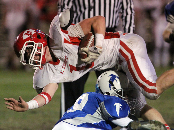 Danvers: Masco senior running back Austin Cashin (1) plows forward for additional yardage while being taken down by Danvers freshman Matt Andreas (29) on Friday evening. The Chieftans defeated the Falcons 30-0 to advance in the D3 Northeast playoffs. David Le/Salem News