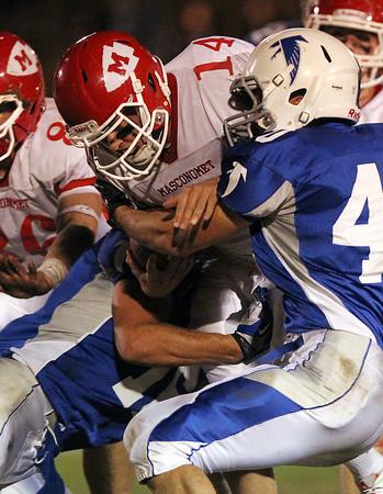 Danvers: Masco senior quarterback Troy Bunker (14) gets taken down by Danvers senior Andy Curtin (40) on Friday evening. David Le/Salem News