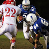 Danvers: Danvers senior running back Alex Valles (21) and the Falcons couldn't find running room against a stifling Masco defense on Friday evening. David Le/Salem News