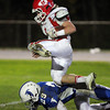 Danvers: Masco senior running back Austin Cashin (1) gets upended by Danvers freshman safety Matt Andreas (29) during the third quarter of play on Friday evening. David Le/Salem News