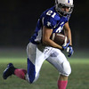 Danvers: Danvers senior captain Alex Valles looks to lower his shoulder and plow ahead for a few more yards against Revere on Friday evening. David Le/Salem News