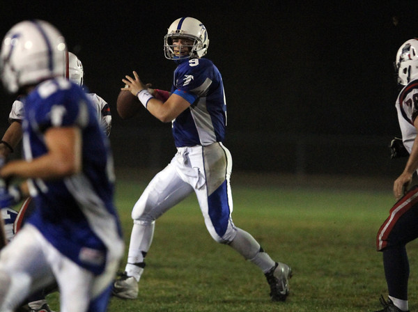 Danvers: Danvers junior quarterback Nick Andreas rolls to his right and looks to pass against Revere. David Le/Salem News