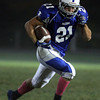 Danvers: Danvers senior captain Alex Valles turns the corner and sprints untouched into the end zone for a 58-yard touchdown run to start off the second half for the Falcons on Friday evening. David Le/Salem News