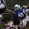 Danvers: Danvers senior Andy Curtin (40) makes a lunging arm tackle of Revere running back Tommy Portrait (24) on Friday evening. David Le/Salem News