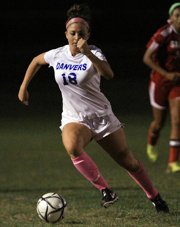 Danvers: Danvers senior midfielder Courtney Arnoldy (18) carries the ball upfield against Salem on Wednesday evening. David Le/Salem News