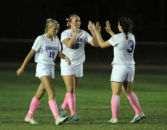 Danvers: Danvers junior striker Shannon Pohle (16) gets high fives from senior captain Kylie Plaza (3) after Pohle netted her third goal of the game against Salem. David Le/Salem News