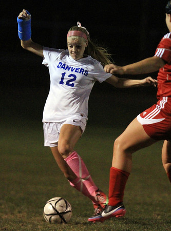 Danvers: Danvers junior Meaghan McCarriston (12) controls the ball while sprinting upfield against Salem on Wednesday evening. David Le/Salem News