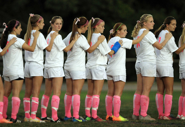 Danvers: The Danvers High School girls soccer team wore special shirts to support Breast Cancer Awareness month as well as pink socks and pink ribbons in their hair for their game against Salem on Wednesday evening. David Le/Salem News