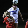 Danvers: Danvers senior midfielder Courtney Arnoldy (18) wins a header over Salem freshman Tayla O'Leary (15) on Wednesday evening. David Le/Salem News