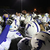 Winthrop: The Danvers High School football team gathers in a tight huddle after defeating Winthrop 39-27 on Saturday evening. David Le/Salem News