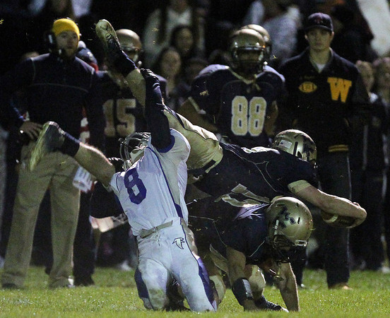 Winthrop: Danvers sophomore linebacker Dan Papagalis (8) upends Winthrop quarterback Jordan Corbett-Frank. David Le/Salem News