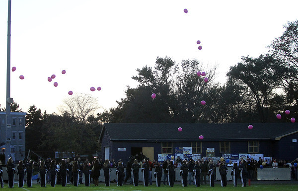 Winthrop: The Winthrop High School cheerleaders release pink balloons in the air as part of a moment of silence remembrance for Danvers High School teacher and Andover native Colleen Ritzer. David Le/Salem News