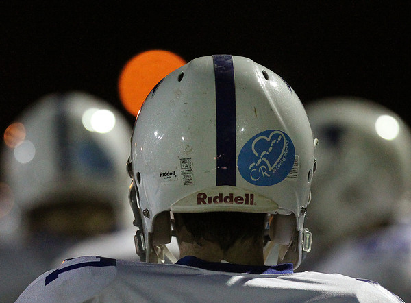 Winthrop: The Danvers High School football team all wore decals honoring their teacher Colleen Ritzer during their game against Winthrop on Saturday evening. David Le/Salem News