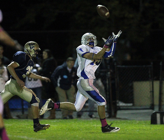 Winthrop: Danvers senior wide receiver Lucas Lentine (15) hauls in a 42-yard touchdown pass from junior quarterback Nick Andreas against Winthrop to put the Falcons up 27-14. David Le/Salem News
