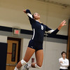 Wenham: Gordon freshman libero Maggie Risma (6) leaps high in the air and aces a serve against Salem State on Saturday morning. David Le/Salem News