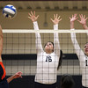 Wenham: Gordon College senior Chelsie Clemens (16) and junior Faith Gerdes (10) leap high in the air and try to block a spike from Salem State freshman Jerika Santiago (4) on Saturday morning. David Le/Salem News