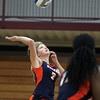 Wenham: Salem State sophomore Sarah Collins (2) leaps high in the air and spikes the ball over the net against Gordon on Saturday morning. David Le/Salem News