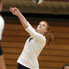 Wenham: Gordon College junior Laura Schmidt (9) volleys the ball over the net against Salem State on Saturday morning. David Le/Salem News