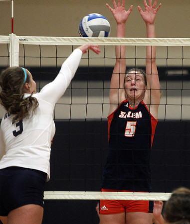 Wenham: Salem State senior Nicole Roscoe (5) leaps high in the air and tries to block a shot from Gordon sophomore Jessica Burdick (3) on Saturday morning. David Le/Salem News