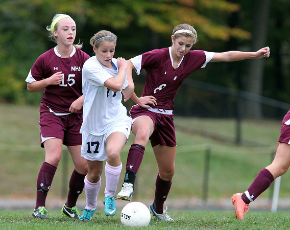 Hamilton: Hamilton-Wenham junior Jillian Kefalas (17) and Newburyport senior Julia Kipp (8) battle for the ball on Wednesday afternoon. David Le/Newburyport Daily News